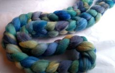 4 oz. spinning roving 100% polwarth wool - soft with long fibres. fabulous wearability for socks. hand-dyed by Oceanwind Knits. handwash. (will felt).