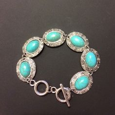 Antique silver plated turquoise bracelet. New antique silver plated turquoise bracelet. It comes in a bag. Jewelry Bracelets