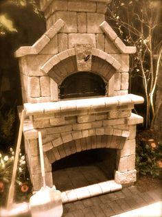 Just like Gwyneth! Backyard Wood Burning Pizza Oven by Unilock. National Home Show 2012
