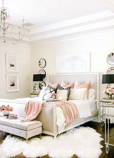 a light grey bedroom with touches of pink and lavender for a romantic feel