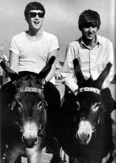 1963 - John Lennon and George Harrison.