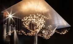 commissioned light by Studio Drift. Flylight at PAD Paris glass tubes represent birds in flight