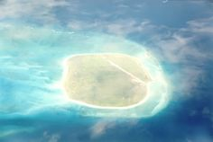 Beautiful photo, taken from the air, of the Glorioso Islands in the Indian Ocean. Panoramic view of Glorieuses Islands taken from inside an airplane Countries Of The World, Islands, Africa, Ocean, Sky, Nature, Outdoor, Airplane, Image