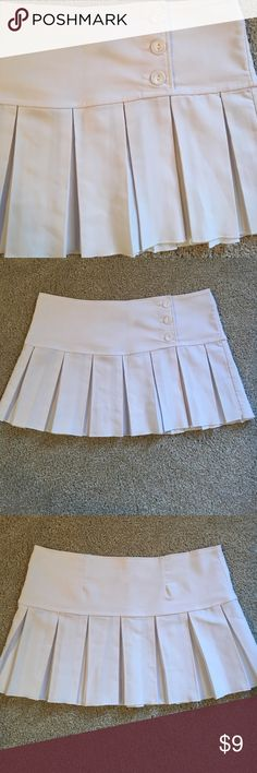 NWOT White Tennis Skirt White tennis skirt. New without tags. Love the look. Bought thinking I'd wear all the time. Never wore. Valia Skirts