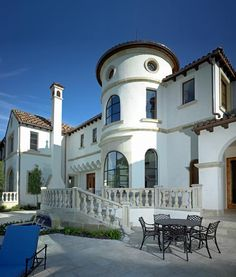 Spanish style architecture at the Creeks of Preston Hollow. Spanish style designs usually feature towers or turrets, white stucco exterior, terracotta roof tiles, ornamental iron work, arcades, romantic balconies, & courtyards | Platinum Series Homes by Mark Molthan