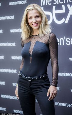 Bodycon beauty: Elsa donned a form-fitting top with a low-cut slit and sheer net panels fo...