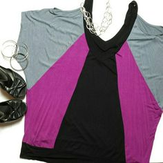"Plus Size 2X / 3X Open Shoulder Colorblock Top Super cute, soft and stretchy! Colorblock black, raspberry purple, grey. Open shoulder slits, deep V-neck front and back, banded bottom.  Julie's Closet brand. The size tag has been cut but I believe it's a 2X or 3X. Please check measurements below. Lots of stretch overall. Soft like rayon blend.  * FLAT MEASUREMENTS *  Armpit-to-armpit 26"" (dolman). Across the bottom 22"". Length shoulder to bottom 29"".  * CONDITION *  Gently pre-loved…"