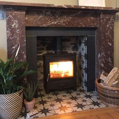 These Scintilla Black Star Pattern Tiles are ideal for creating a striking statement floor in any interior space. Fireplace Hearth Tiles, Victorian Fireplace Tiles, Edwardian Fireplace, Wood Burner Fireplace, Simple Fireplace, Fireplace Surrounds, Fireplace Design, Fireplace Fender, Fireplace Kitchen