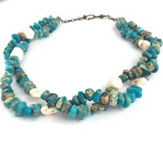 """Bleu Jasper Necklace Complete your spring / summer look with this brilliant and bold natural sea sediment jasper gemstone necklace, handcrafted in our studio as part of our Boho Luxe jewellery range. This stunning 'Bleu' layered necklace, finished off with natural white turquoise nuggets and an antique bronze chain with hook and eye fastening, measures approximately 20"""" in length. http://www.luxierefashion.co.uk/product/bleu-jasper-necklace/"""