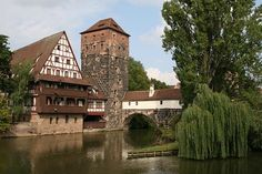 The 'Weinstadel' building and the Pegnitz River in Nuremberg