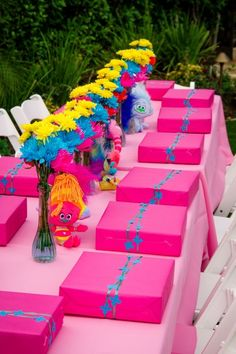 Trolls themed birthday party kids table decoration with favors