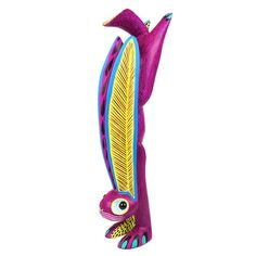 Very unique hand-standing rabbit alebrije wood carving by top Oaxacan artist Arsenio Morales. Arsenios marble eyed rabbits have become a must-have for alebrije collectors worldwide. His style has become one of the most recognizable to come out of Arrazola, Oaxaca Mexico.  Height/Length/Width: 15.75 x 5 x 3.5 Features: Copal wood Signed by the artist  Origin: Oaxaca, Mexico  Alebrijes are magical and colorful creations made out of copal wood in Oaxaca, Mexico. Each carving is one-of-...