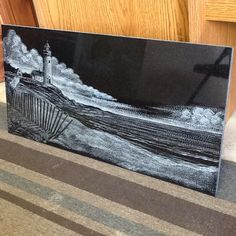 """This is a Premium pick Granite Tile 12x 24"""" with a Lighthouse Beach Scene Etched throughout !"""