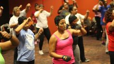 Fitness instructor Nicki Jones leads an exercise class at Lucile H. Bluford Library in Kansas City. (Calvin Jones/for WHYY)
