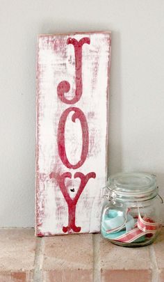 This classic joy sign is made from recycled wood and is painted with a satin fiish. All signs are unique to the wood. Dimentions are approximately 17