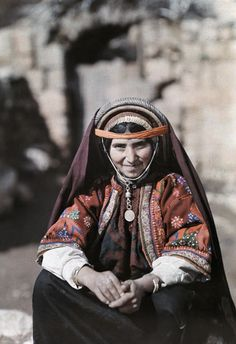 Palestine | A Muslim matron of El-Bireh sits on a stoop. | ©Maynard Owen Williams