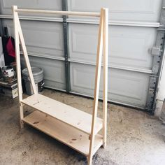 DIY: Kids Wood Clothing Rack - This Bliss Life <br> Need a space for dress up clothes or costumes? Learn how to build a kids wood clothing rack otherwise known as an open wardrobe!