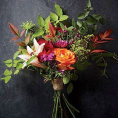 Create a lush, artistic bouquet by pairing greenery (snipped straight from the yard) with grocery store blooms. #MySouthernLiving : Becky Luigart-Stayner