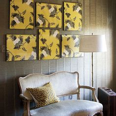 """Wanting to give the wall across from the bed some pizzazz, Anne Turner came up with a great idea: Instead of buying art, make some! She found a roll of floral-patterned wallpaper, cut it into pieces, and put them in ready-made frames. """"Covering the whole wall with this print would have been way too much both visually and cost wise,"""" she explains. """"But hung in pieces in a geometric arrangement above the settee, it's just the right amount.""""      Artwork: Berry Flower Wallpaper in Lemon Curd by…"""