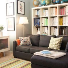 Gray couch and IKEA bookcase