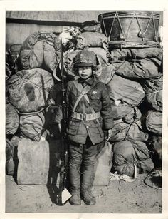 12-year-old boy soldier of the 22nd Division of the Chinese 6th Army in Shang hai, China (1-30-46)