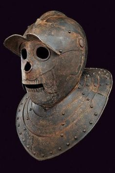 The Savoyard helms - a type of closed burgonet in use in the XVIIth century, it was also called the death's head helmet in German and the Tête de cul in French