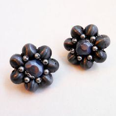 Vintage 60s Grey Cluster Bead Clip Earrings made in Japan.    Love These! The photos dont do them justice. The plastic beads have a shine to them