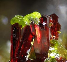 Gartrellite (lime green): Iron Copper Arsenic Lead. Carminite (brownish red): Aluminum Iron Cobalt Copper Arsenic Lead