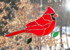 Beautiful stained glass cardinal made in the Tiffany copper foil method. Cardinal with leaves on a copper branch. You will receive the cardinal pictured. Size Approx: 11 x 7 Glass Flowers, Glass Birds, Cardinal Pictures, Copper Branch, Stained Glass Cardinal, Stained Glass Projects, Suncatchers, Tiffany, Christmas Ornaments