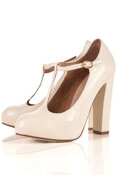 cream colour. chunky heels, t-straps.