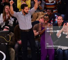 Lupita Nyong'o and guest attend the Philadelphia 76ers vs New York Knicks game at Madison Square Garden, NYC