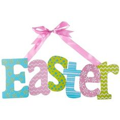 "Celebrate the Easter season with adorable and colorful decor. Multi Pattern Pastel Easter Hanging Sign features polka dots, stripes, chevron, and floral patterns in blue, gold, and white iridescent glitter. With MDF letters in blue, pink, and green, this adorable sign is perfect for hanging on your front door, in your living room or hallway, at your office, and more!    	     	Dimensions:    	  		Length: 6 1/4""  	  		Width: 18 1/4""      	     	Hanging Hardware: 1 - Attached Pink Satin Ribbon…"
