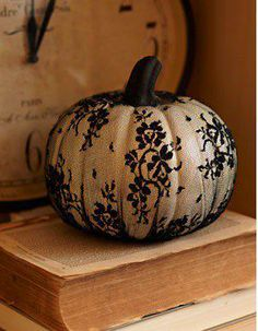 I would LOVE to wrap some white pumpkins in black lace for Halloween. LOVE LOVE LOVE