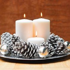 DIY Holiday Candle Centerpiece-simple white candles, pine cones w/ either spray paint or glitter Noel Christmas, Simple Christmas, Winter Christmas, Christmas Crafts, Magical Christmas, Christmas 2019, Beautiful Christmas, Christmas Wedding, Candle Centerpieces