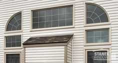 Custom-shapes, fixed and double-hung windows with colonial grids. Beige exterior color. #homeimprovement #homedesign