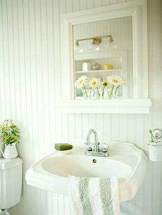 Bright white/yellow/vibrant green bathroom w daisies...love the color/theme idea, not so much the wainscoting...