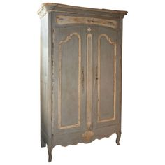 Early 19th Century French Provencale Armoire In Painted Oak | From a unique collection of antique and modern wardrobes and armoires at https://www.1stdibs.com/furniture/storage-case-pieces/wardrobes-armoires/