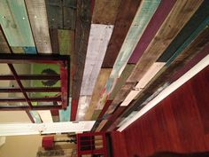My reclaimed wood wall, made from pallets. My friend and I used a sawzall to cut the pallets apart, then I painted and stained the boards in different colors. The paints I used are colors that I've used on other furniture projects in my house.