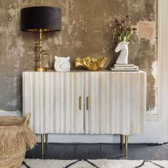 A whitewashed wooden sideboard with a textured chevron design beautifully hand carved by skilled artisans. Sitting Room Lights, Gold Lamp Shades, Gold Floor Lamp, Gold Table, Light Table, New Furniture, Sideboard, Table Lamp, Carving