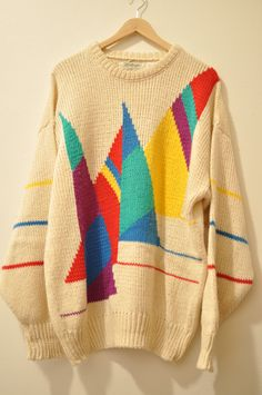 shopblushingambition: VINTAGE OVERSIZED COLORFUL SWEATER Crazy linen and cotton blend sweater with a unique design! I've never seen anything like this! It's long enough to wear over leggings or with skinny jeans and flats. would best fit an oversized medium or large $42 SHIPPED
