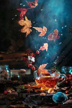 Autumn Leaves Falling Into Tea