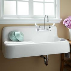 """42"""" Cast Iron Wall-Hung Kitchen Sink With Drainboard, Signature Hardware, via Remodelista. $895. Also think laundry rooms, mud rooms, bathrooms."""