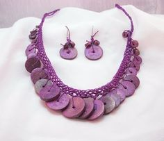This would be a very quick & easy crochet necklace to do for a beginner. Use shells, buttons or beads