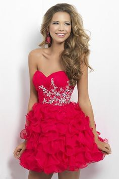 This dress is blood red with some super cute sparkles at the top and ruffles at the bottom. #homecomingdresses
