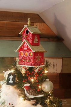 ~  Birdhouse Tree Topper ~ Tutorial by Pretty Handy Girl....What a fun idea for trees w/ a outdoors theme(weathered barn lumber birdhouse instead of painted thought)....