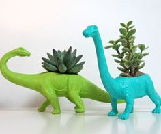 Dinosaur Planters $14.50....fuck that. I'm going to make these next time I hit up a mold-o-Rama.