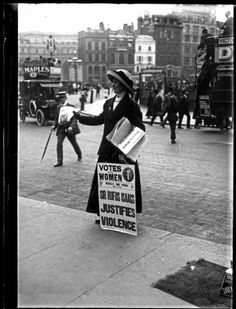The suffragette is selling the 'Votes for Women' newspaper outside Morley's Hotel in Trafalgar Square. This edition of the 'Votes for Women' newspaper was published on Friday 29th April 1910.