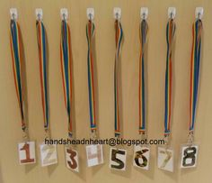 Why didn't I think of this? TOTALLY MAKING THESE FOR THIS YEAR! Great way to designate helpers and keep track of who is out of their seats that should not be during clean up. May take this one step further and instead of table numbers, make them with a job/picture i.e. collect pencils, markers, brushes, paper, clean tables, etc.