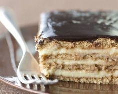 """An unconventional combination: the flavors of a Boston cream pie are transformed into a casserole-style dessert that does not need any time in the oven. Homemade pudding is layered with a crunchy graham crackers and fudgy chocolate frosting. After it rests overnight in the refrigerator, it takes on a cake-like consistency, kind of like an icebox cake. Adapted from Faith Durand's """"Not Your Mother's Casseroles."""""""