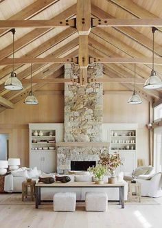 Barn House Stone Fireplace Vaulted Ceiling More House tour of a magnificent beach barn house by Hutker Architects and Martha's Vineyard Interior Design. Vaulted ceilings, exposed beams and ocean views. Stone Fireplace Designs, Stacked Stone Fireplaces, Fireplace Ideas, Fireplace Stone, Fireplace Update, Fireplace Furniture, Beach Style Fireplaces, Fireplace Filler, Fireplace Doors